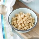 A bowl of canned chick peas from the front