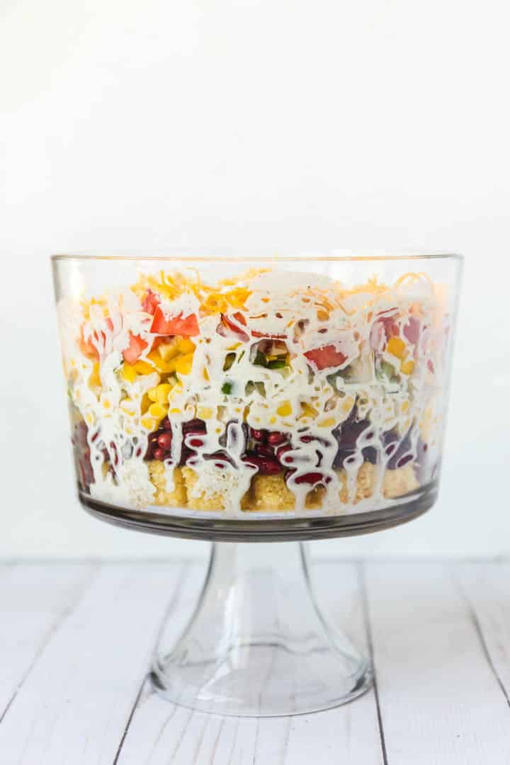 A photo of the side of the cornbread salad in the trifle bowl Southern Cornbread Salad