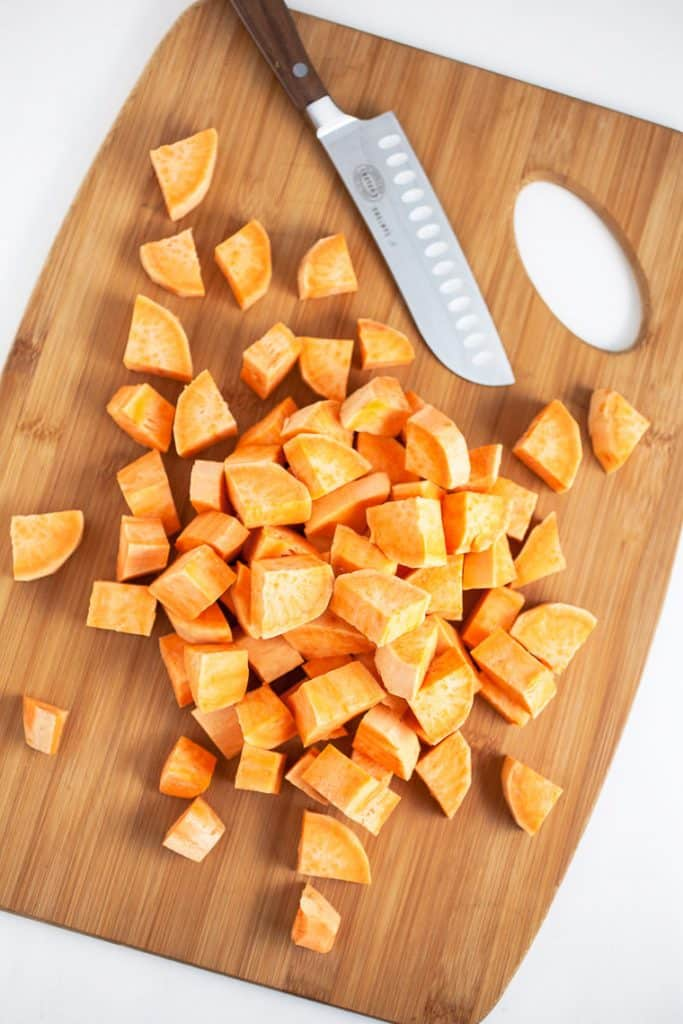 A sweet potato cut up in 1 inch pieces for southern sweet potato casserole
