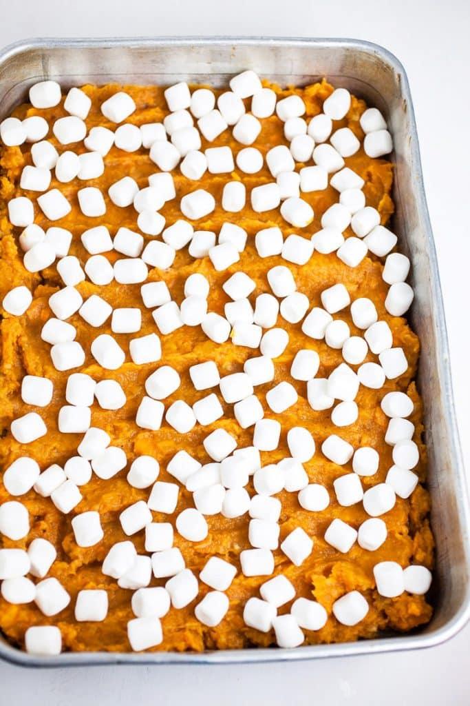 Mini marshmallows on top of southern sweet potato casserole