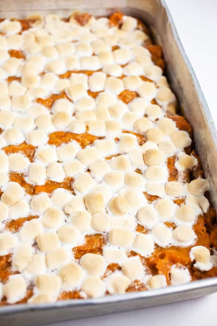 The top of the baked casserole with melted and browned marshmallows