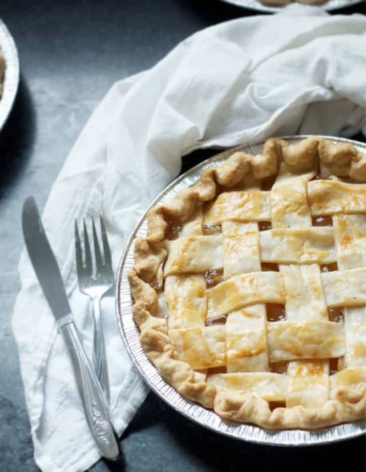 An overhead view of a pie with a fork and knife with How to Make Apple Pie with Apple Pie Filling