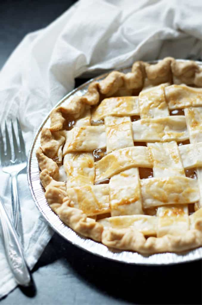 A view of a whole pie and a fork with How to Make Apple Pie with Apple Pie Filling