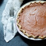 The pie with a fork and napkin for HOW TO MAKE PUMPKIN PIE WITH CANNED PUMPKIN PIE MIX