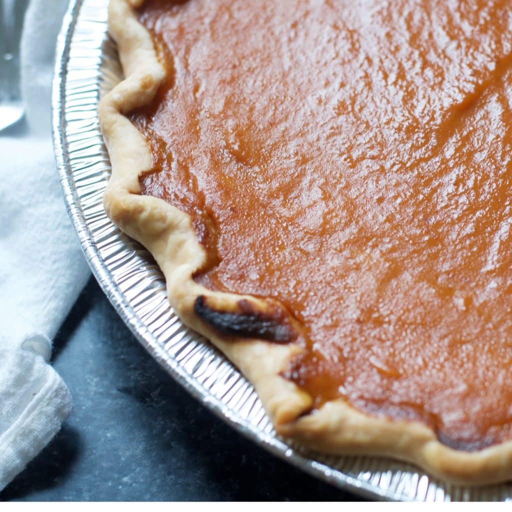 Close up of the baked crust for HOW TO MAKE PUMPKIN PIE WITH CANNED PUMPKIN PIE MIX