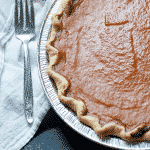 Homemade pumpkin pie recipe using pumpkin pie mix from the can. Canned pumpkin pie mix is easy to use. Just like Paula Deen or Pioneer Woman would make #recipe #thanksgiving #holidaybaking #pumpkinpie