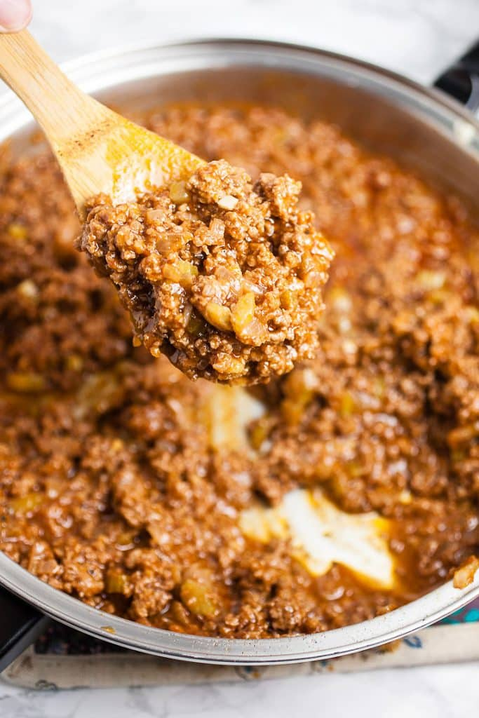 A spoonful of sloppy joe mix for homemade sloppy joe sauce