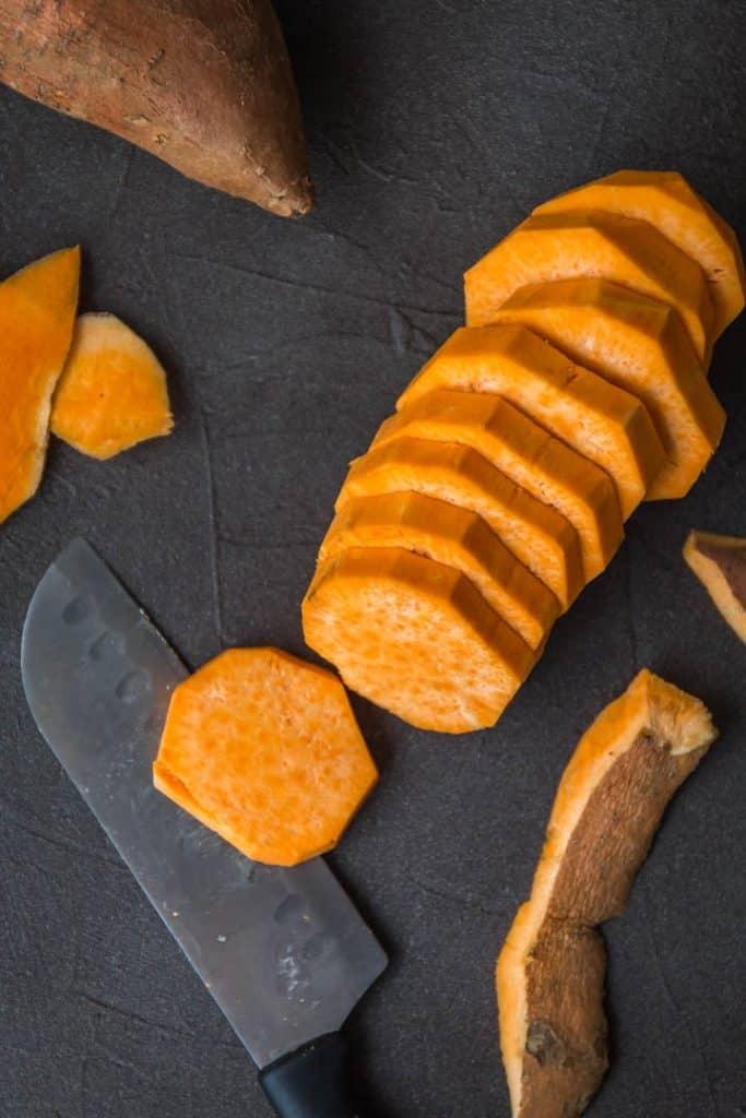 Cut sweet potatoes for sweet potato cobbler