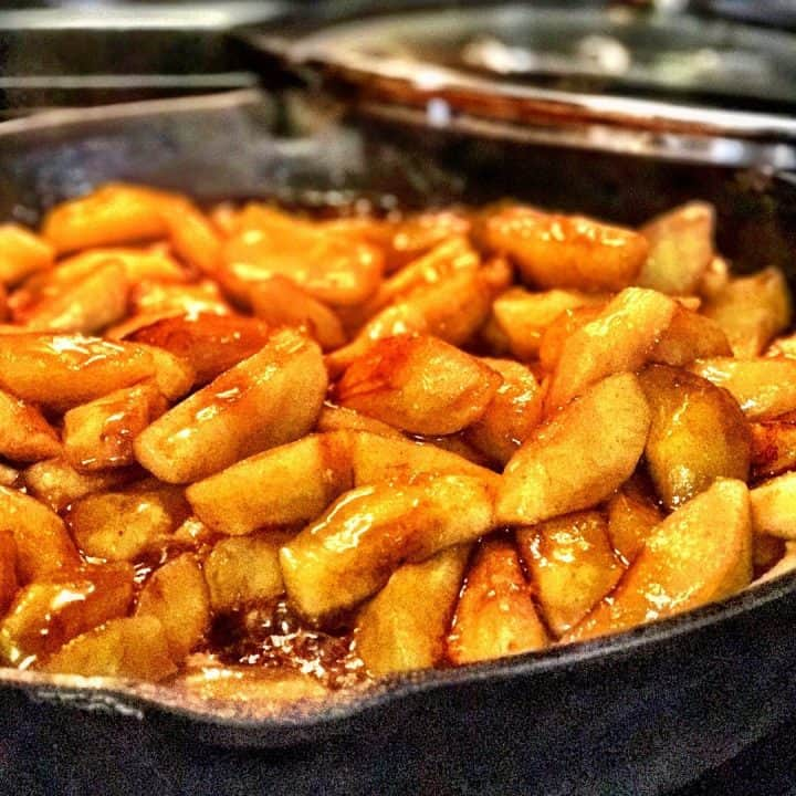 a skillet of fried apples cooking