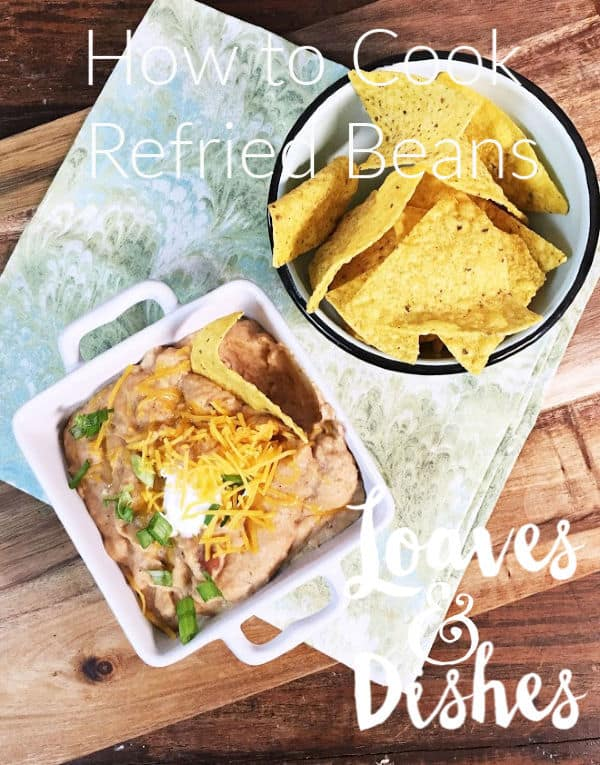 Ever wonder how to make restaurant style refried beans?  Creamy, luscious, delicious with the perfect restaurant flavor?  Refried beans for dip or refried beans for your Mexican Taco night?  These will have you cooking like the Pioneer Woman in no time at all!  #refriedbeans #cannedrefriedbeans #recipe #loavesanddishes