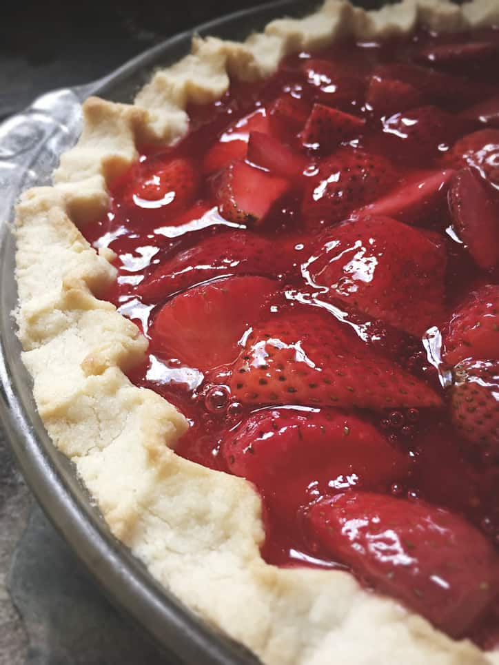 picture of the edge of a strawberry pie with jello and crust