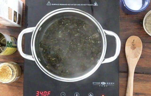 Saucepan heating with steam rising on burner