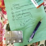 Green paper with list of things to do including RxSaver, pill bottle and pill packet