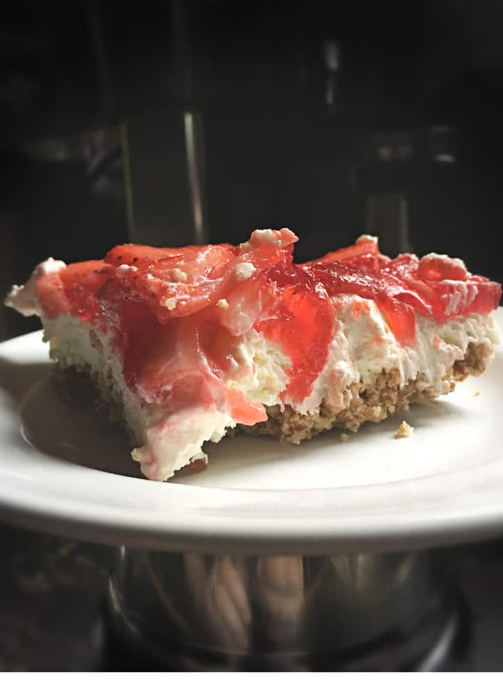 The layers of the easy strawberry pretzel salad from the side.