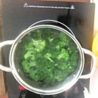 broccoli in a stock pot boiling on stove eye