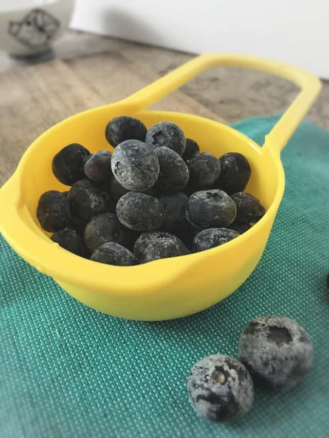 1/2 Cup measure full of frozen blueberries