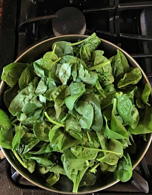 spinach in a frying pan ready to be wilted