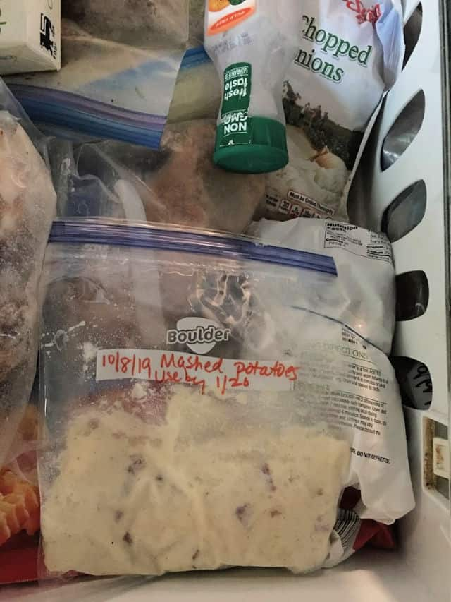mashed potatoes in labeled bag in freezer