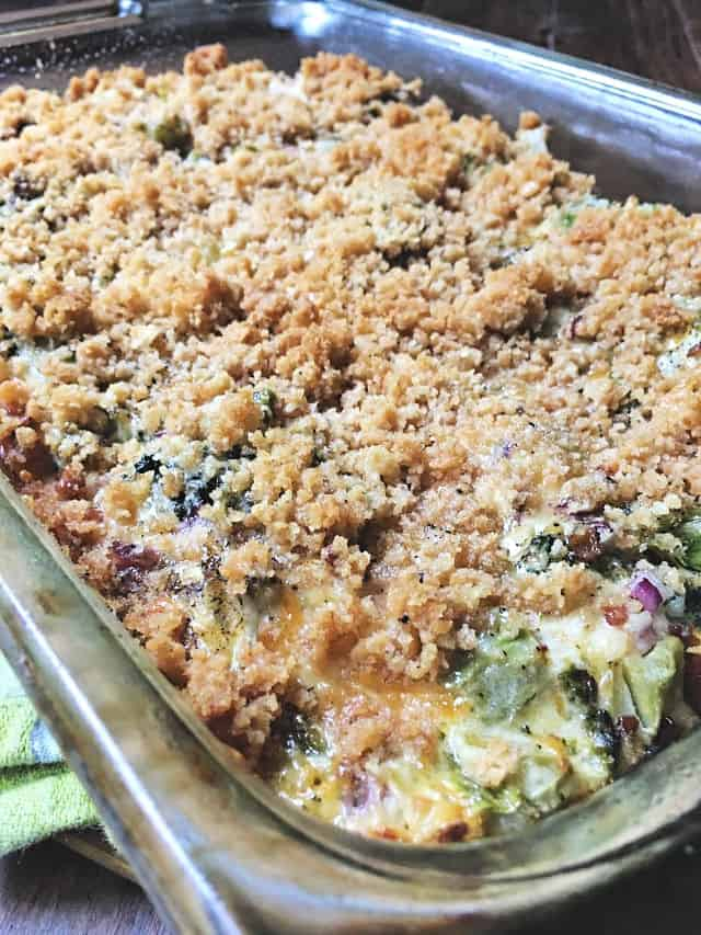 the crumbly crust of broccoli casserole in a glass baking dish
