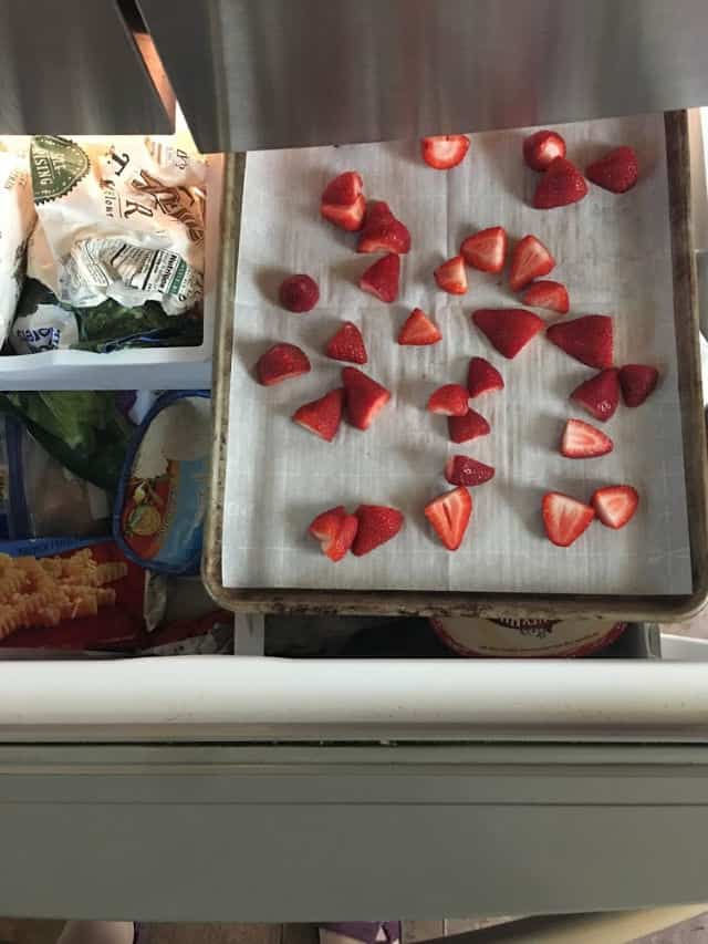 Strawberries in the freezer on a pan