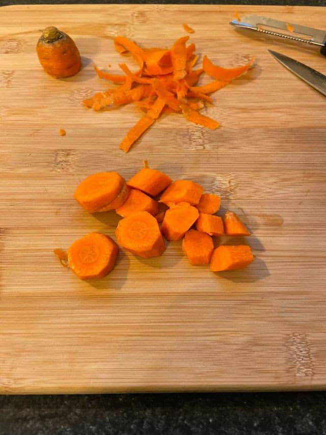 Carrots cut into pieces on cutting board