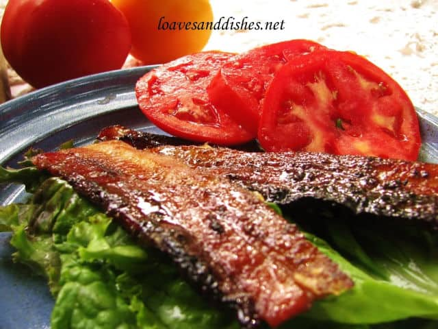 strips of pig candy bacon on lettuce with tomato