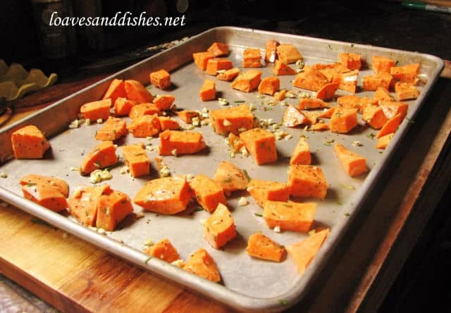 baking sheet with sweet potato scattered