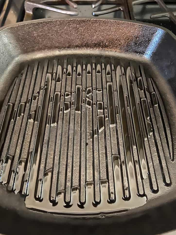black cast iron grill pan with oil