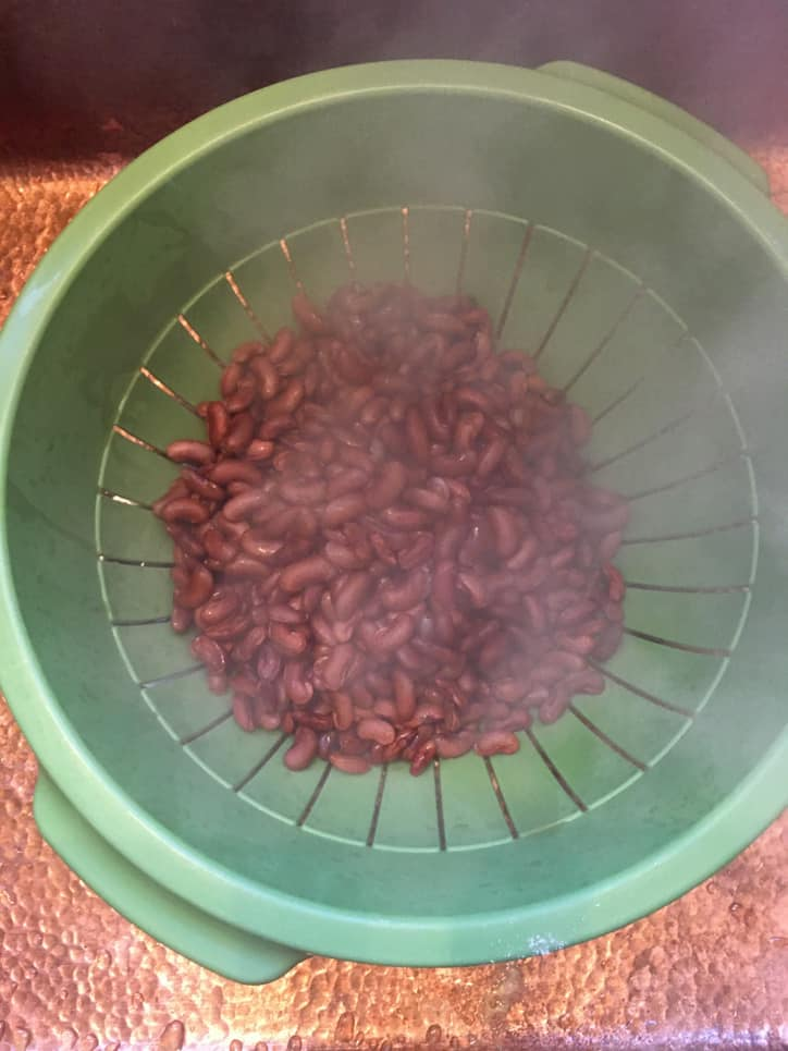colander of red beans with steam rising
