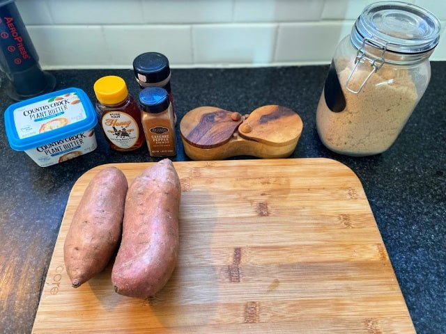 Sweet potatoes and ingredients on cutting board