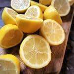 lemons cut in half on wooden cutting board