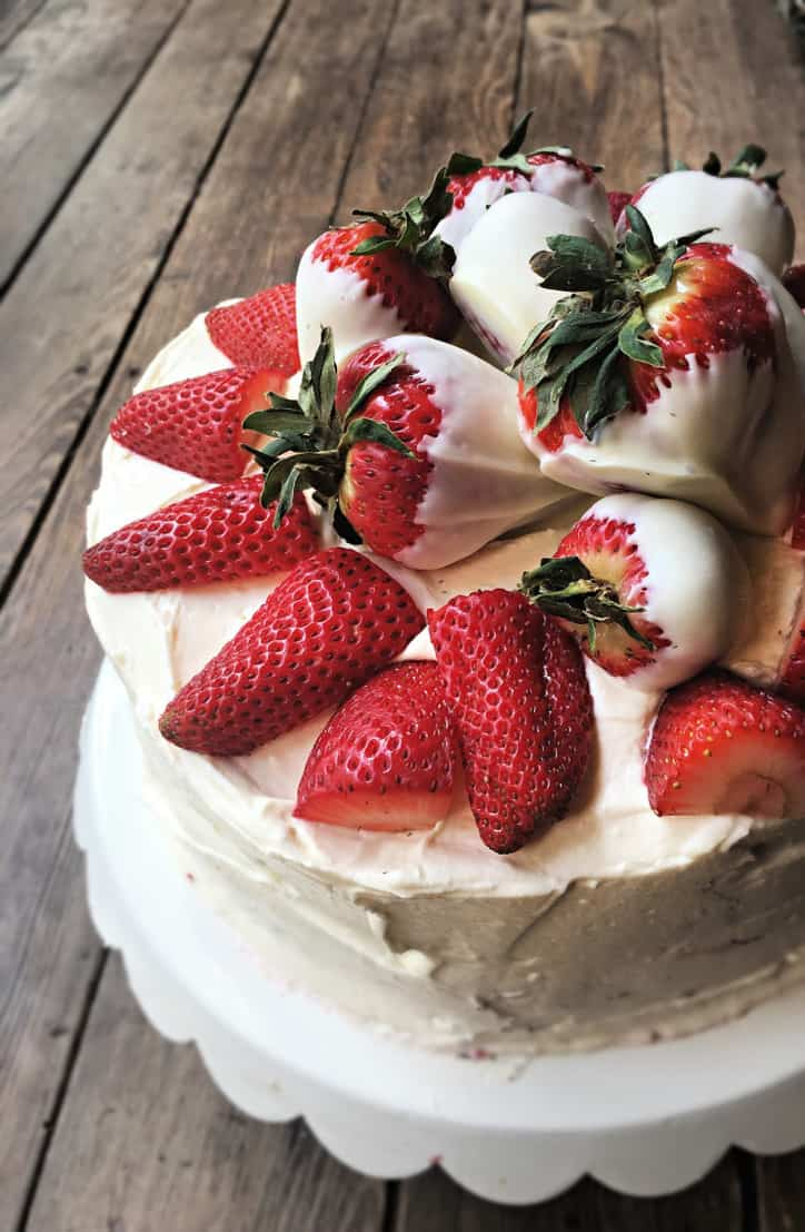 three quarters of cake with strawberries on cake
