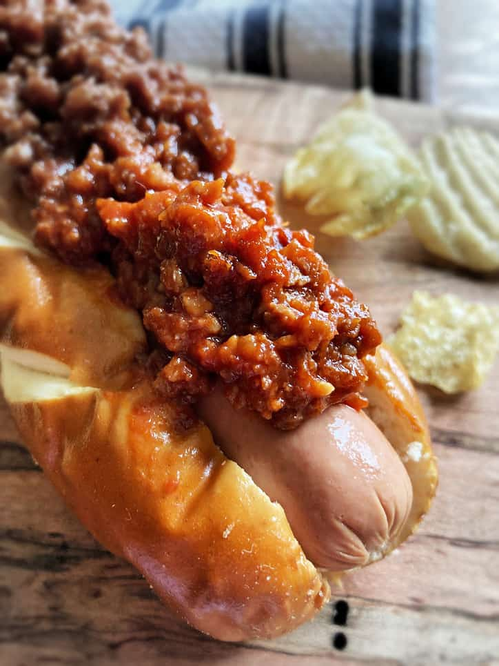 hot dog in bun with hot dog chili on top