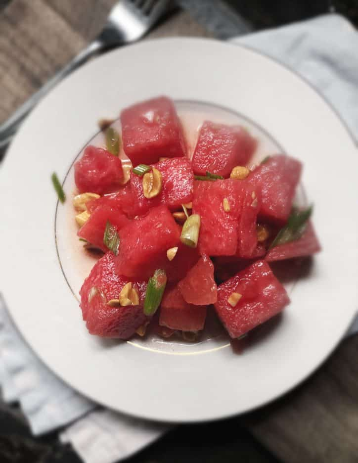 overhead shot of watermelon salad on a plate