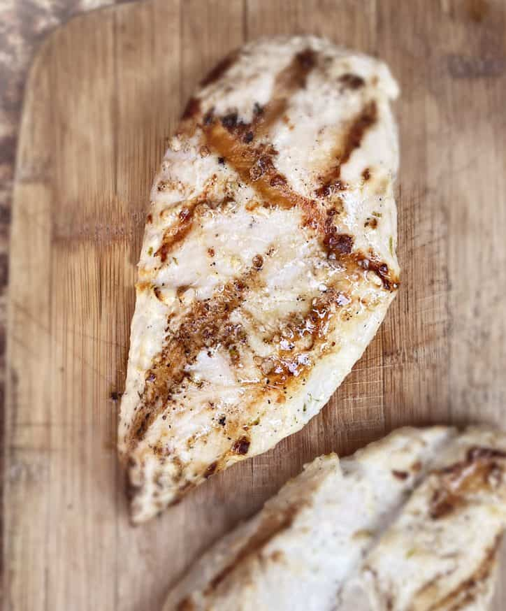 grilled chicken breast on board