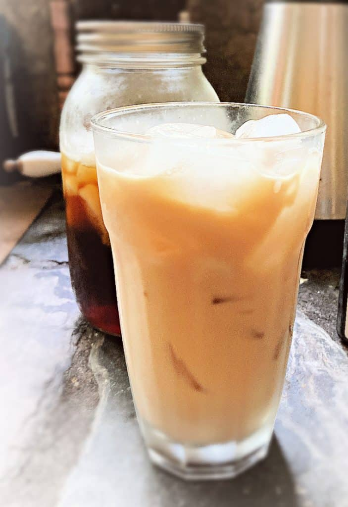 glass of vanilla iced coffee on table