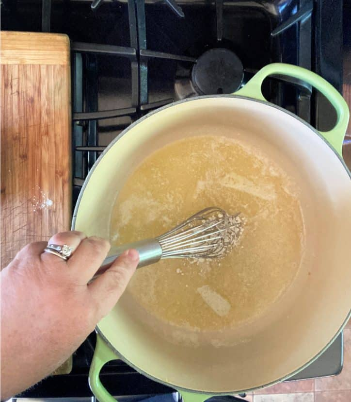 cast iron dutch oven with whisk