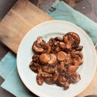 plate of mushrooms on cutting board
