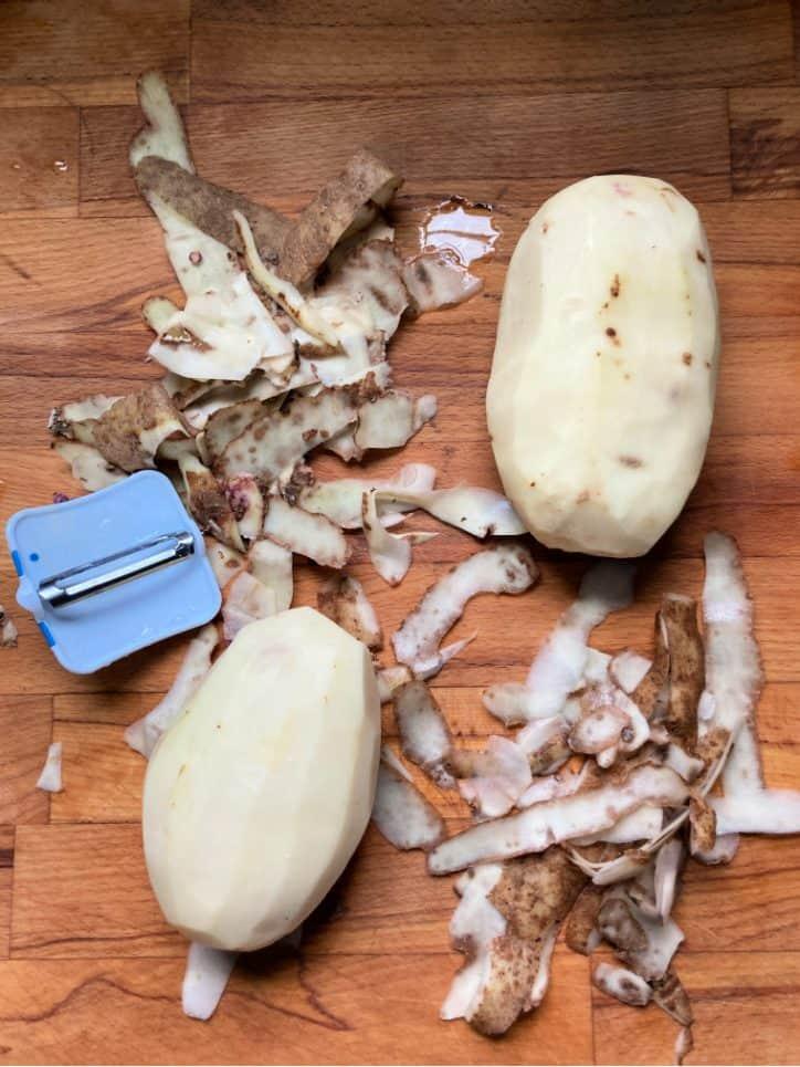 peeled potato on board