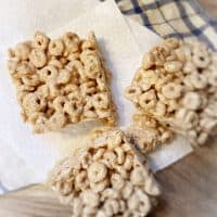 three peanut butter cheerio bars on table