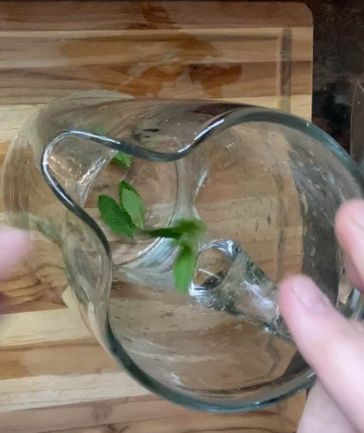 crushing mint leaves