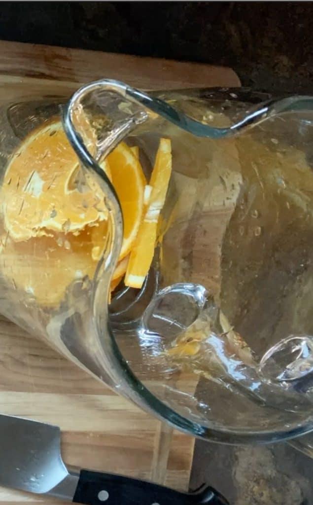 oranges in pitcher