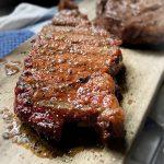 smoked ribeye steak on cutting board