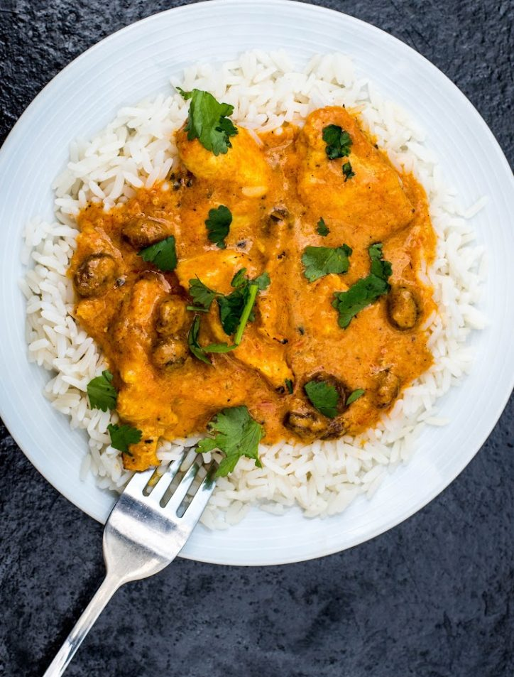 pressure cooker curry chicken on rice on plate