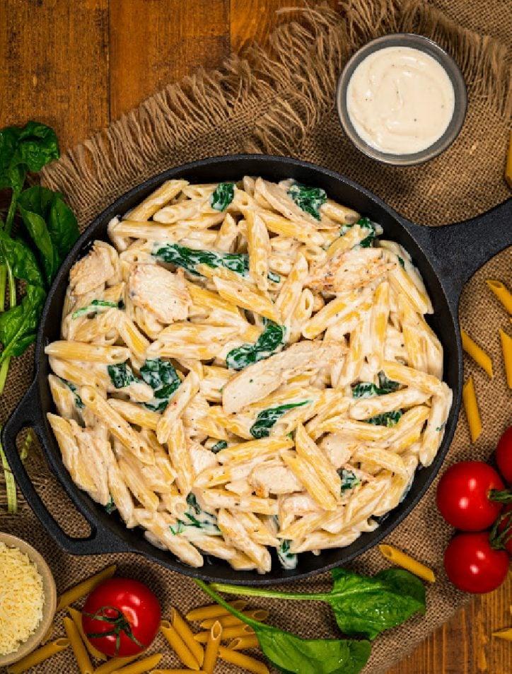 pan of pressure cooker chicken alfredo with jar sauce