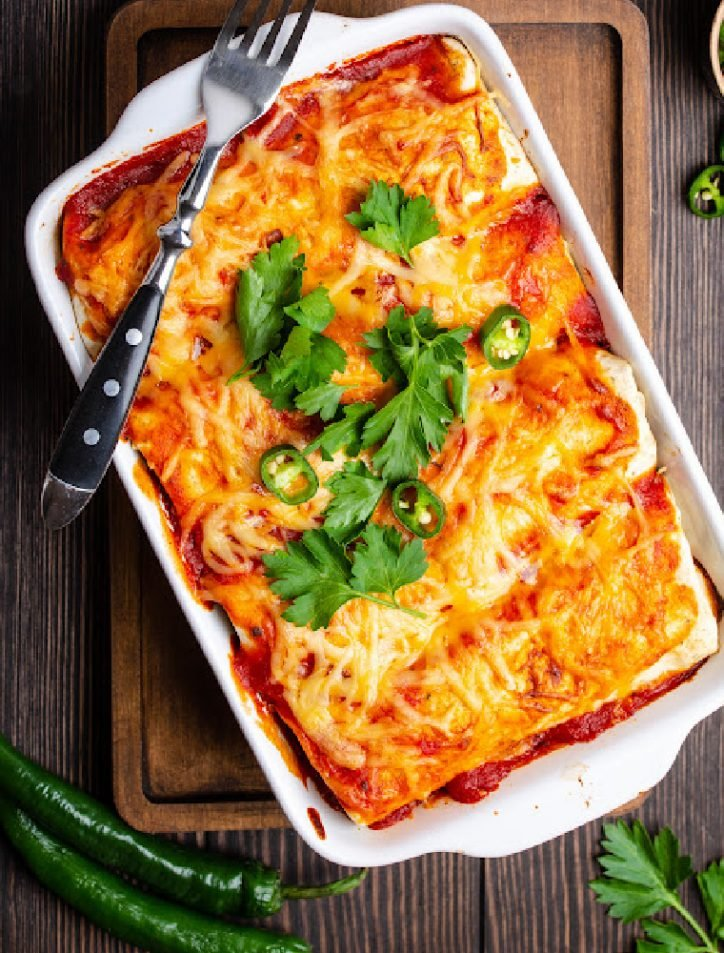 chili relleno casserole with enchilada sauce on table