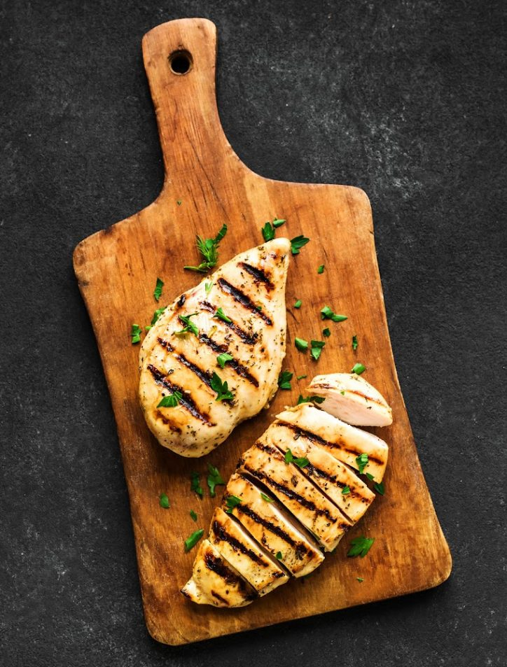 Chicken breasts on a cutting board