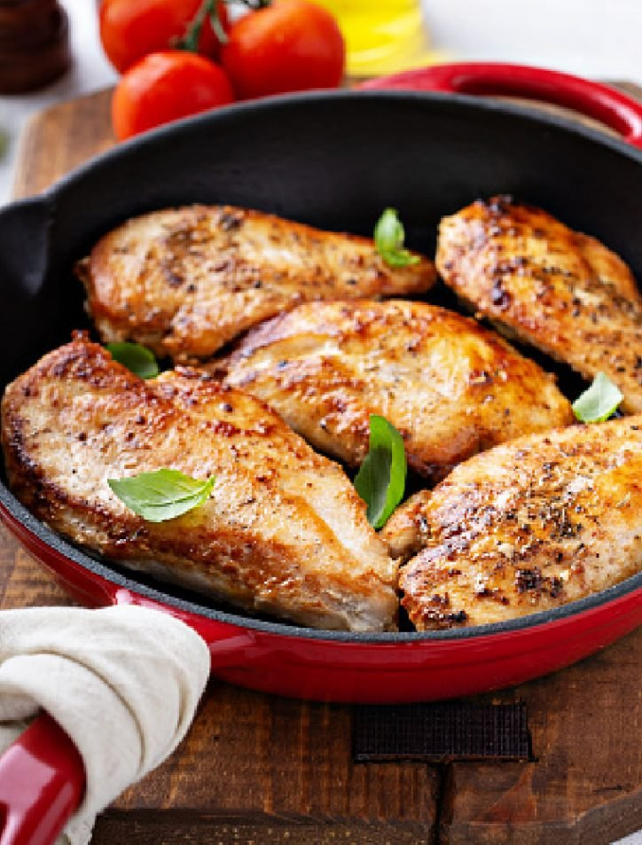 5 chicken breasts in a pan
